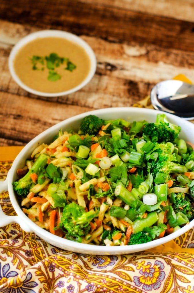 Confetti Vegetables with Spicy Almond Sauce - You know you need to eat your veggies, but sometimes it can be hard to get excited by them. One taste of this spicy almond sauce will have you looking forward to filling your plate!