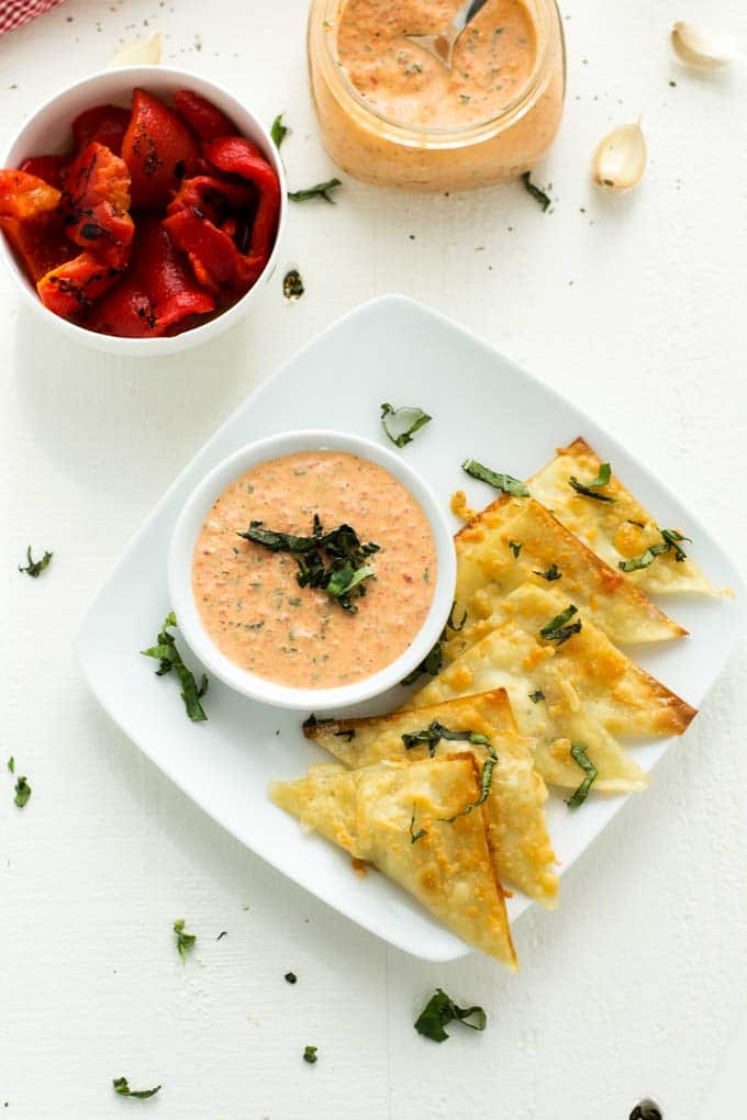 Photo of Goat Cheese Wontons, a bowl of roasted red peppers and a bowl of roasted red pepper garlic sauce