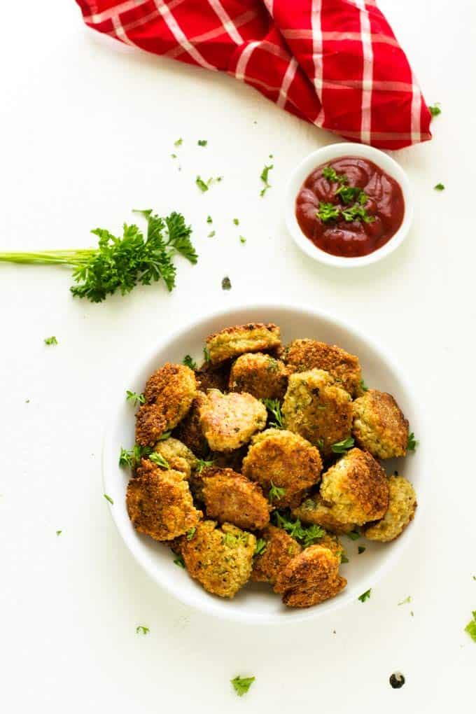 Overhead shot of kid-friendly quinoa fritters on a white plate