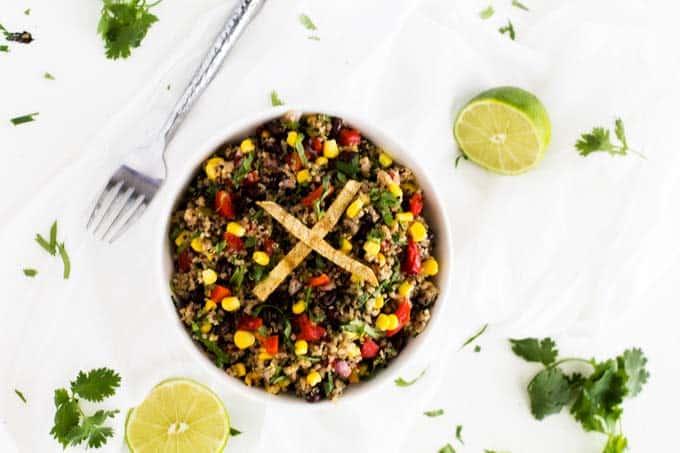 Horizontal shot of Southwestern Quinoa Salad with limes
