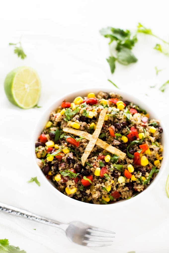 Southwestern Quinoa Salad in a white bowl on a white background.