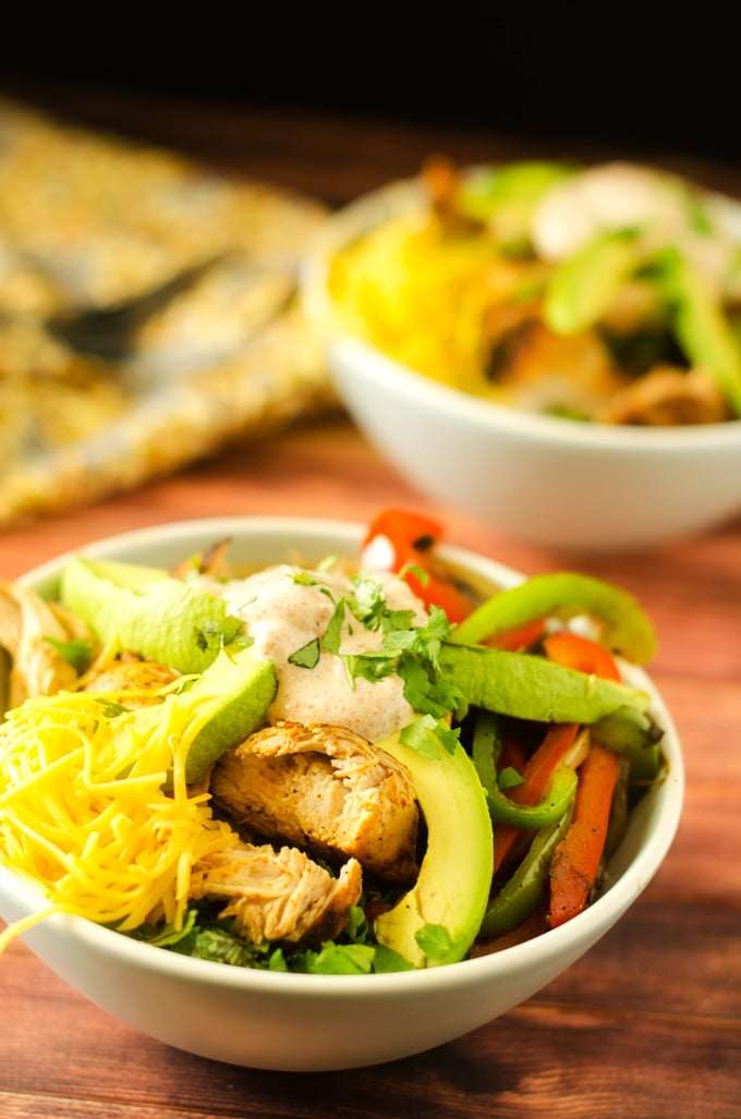 Healthy Fajita Bowls on a dark wooden background in a white bowl.
