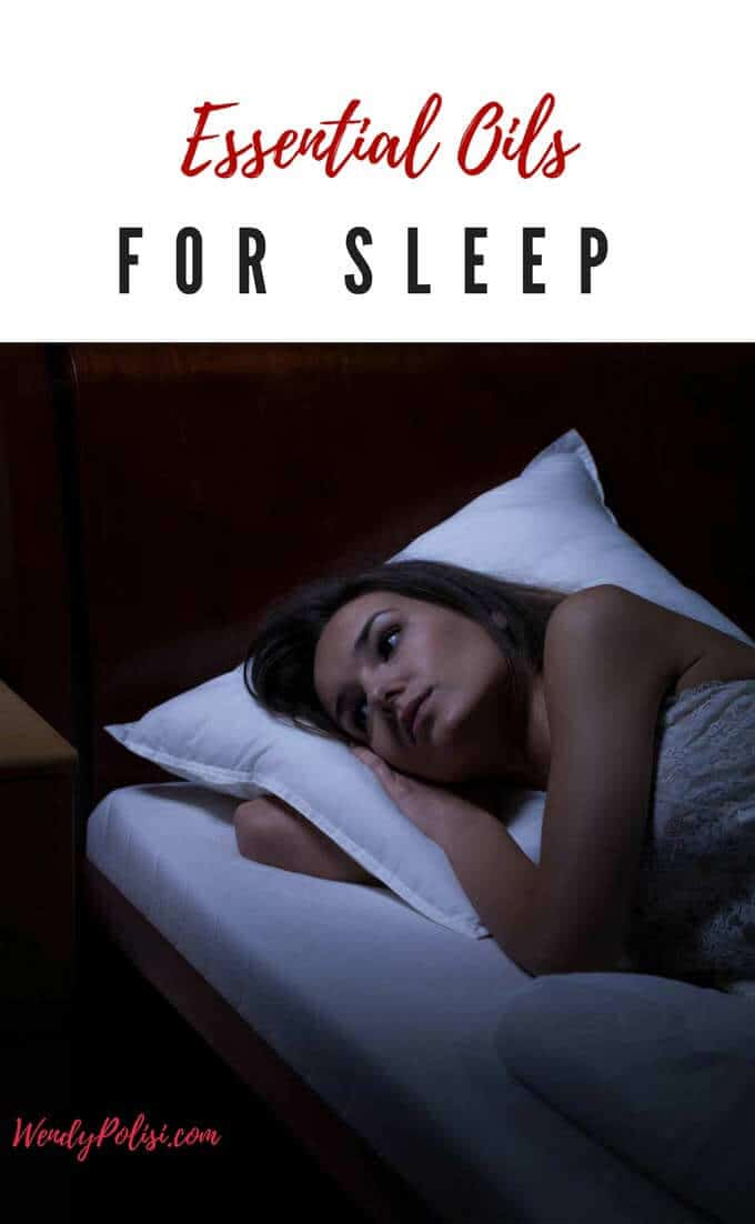 Photo of a sleepless woman lying in bed in the dark with the caption Essential Oils for Sleep above.