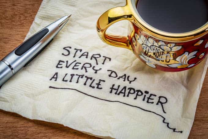 Photo of a napkin that says Start Every Day a Little Happier - oils for depression.