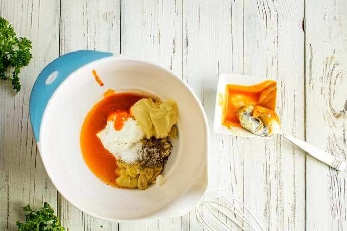 Photo of mayo, Greek yogurt, apple cider vinegar, Dijon mustard, sweetener, hot sauce, sea salt, and celery seeds in a medium bowl.