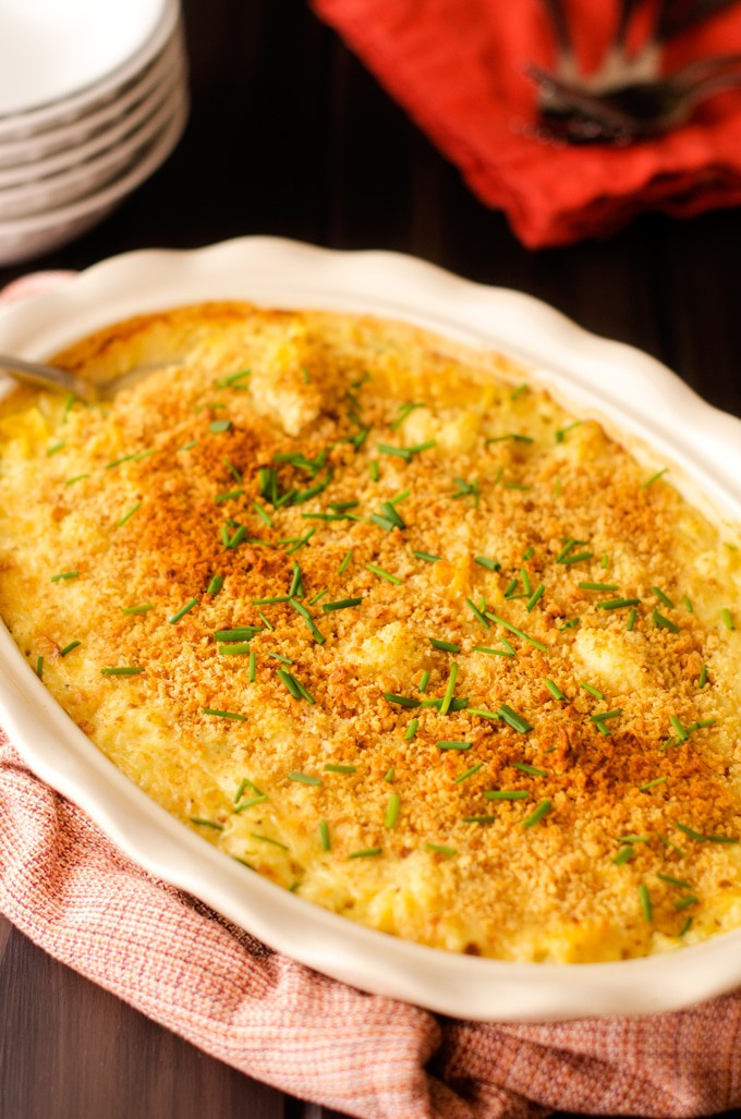 Photo of Skinny Mac and Cheese in an oval baking dish garnished with chives.
