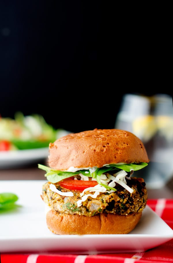 Black Bean Quinoa Cheddar Burger - This gluten free vegetarian burger has a vegan option. With just 202 calories it makes the perfect lunch to help you keep your health goals on track. It is so easy to make and tastes incredible!