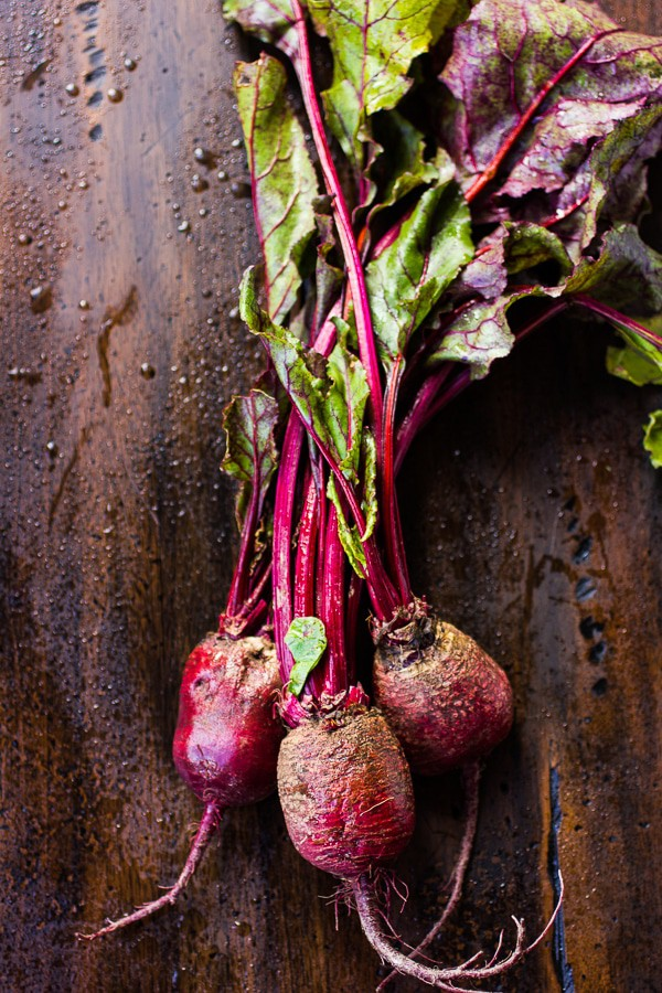 Photo of a bunch of beets on a dark background preparing to make Beet Burgers.