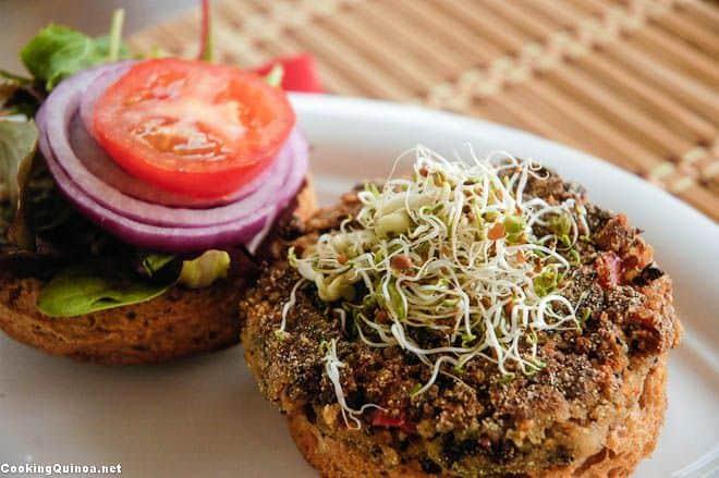 Horizontal Photo of a vegan black bean quinoa burger on a white plate.