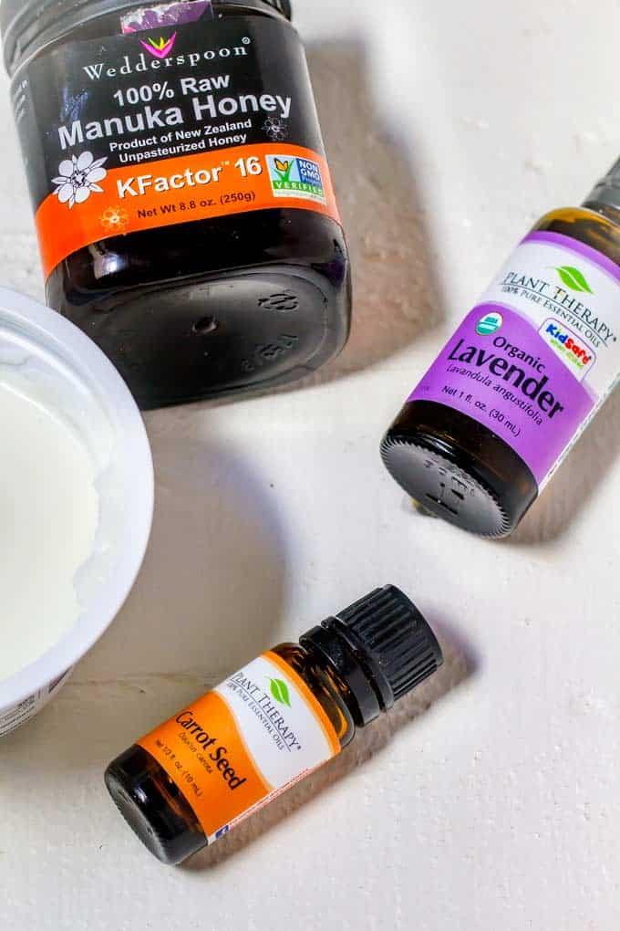 DIY Honey Face Mask ingredients - Carrot Seed Essential Oil, Lavender Essential Oil, Honey and Yogurt