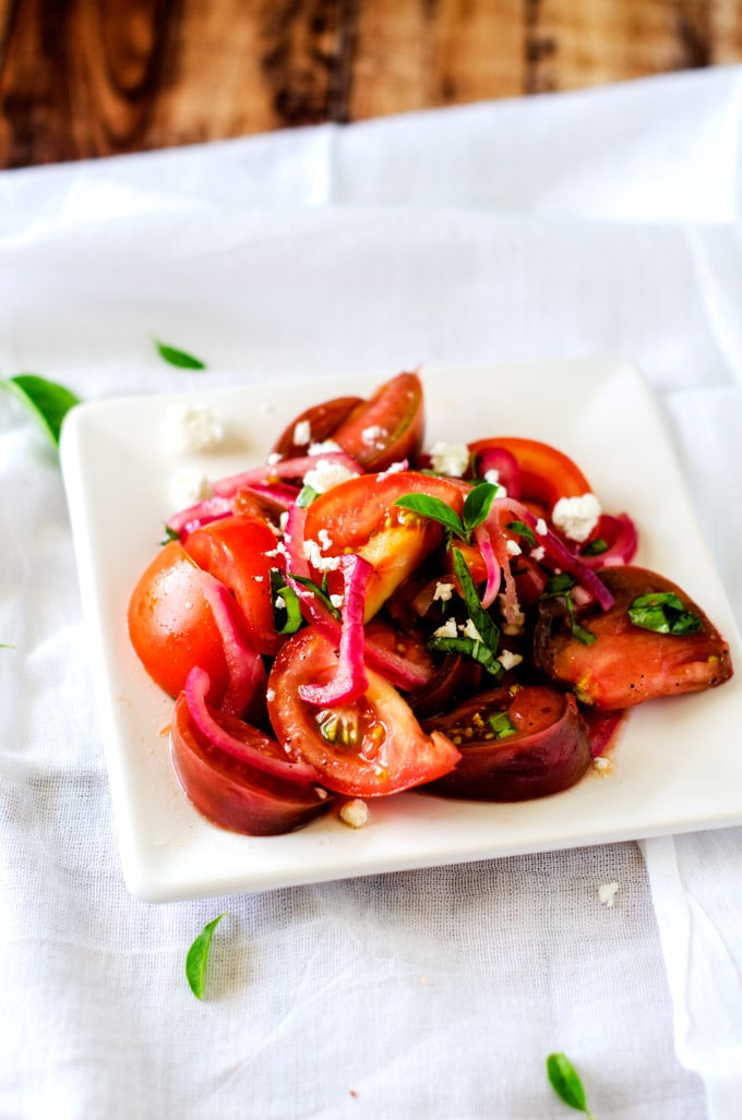 Sliced Tomato, Olive, And Goat Cheese Salad Recipe — Dishmaps