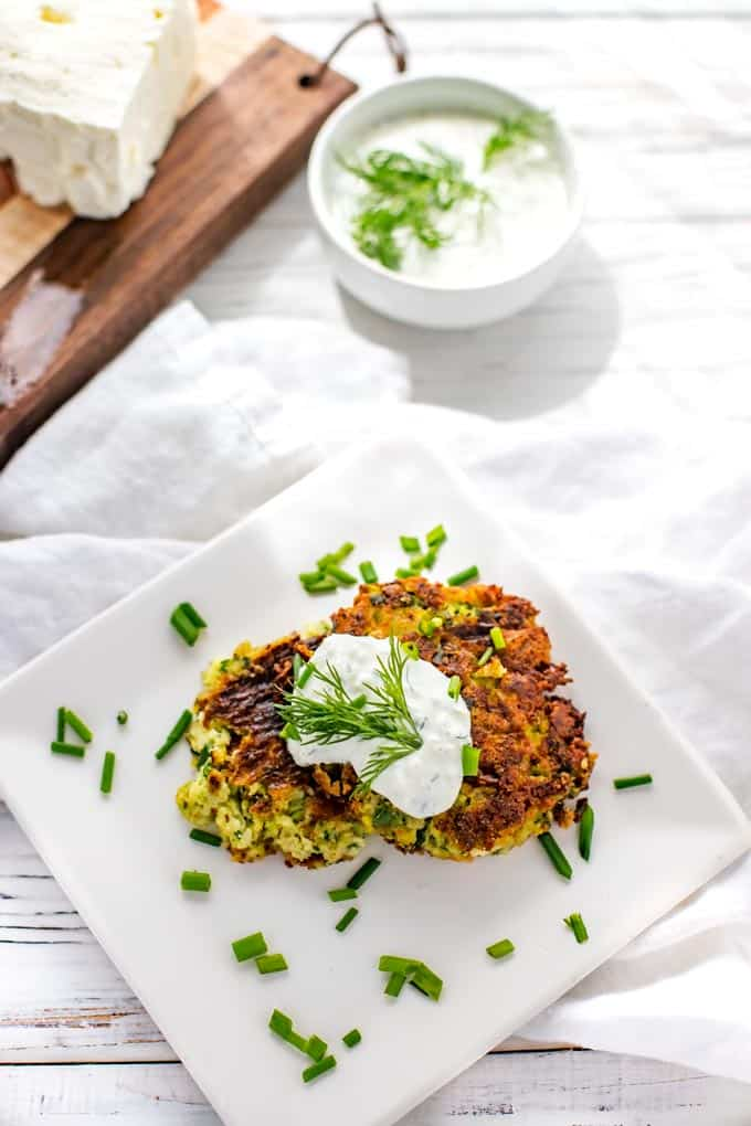 Overhead Photo of Zucchini Fritters Recipe with Feta prepared and plated on a white plate.