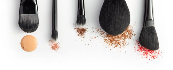 Photo of cosmetic brushed and skin care ingredients .