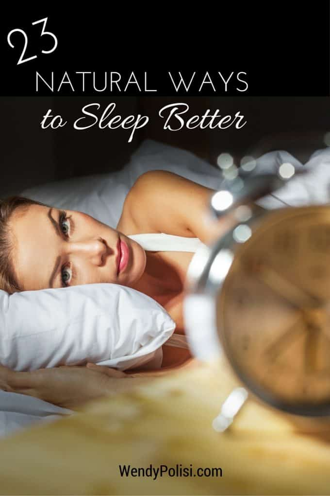 Photo of a woman in bed staring at a clock with the text 23 Natural Ways to Sleep Better.