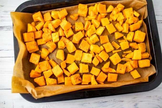 Cubed Butternut Squash in a roasting pan.