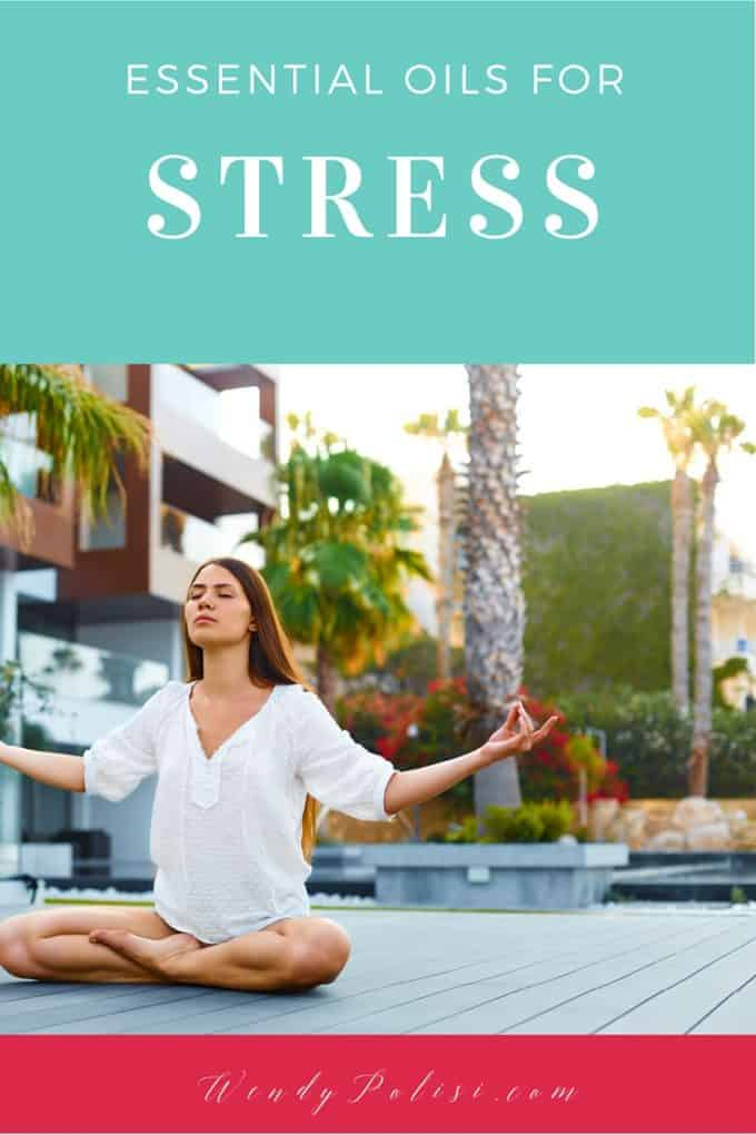 Photo of a woman outdoors on a deck meditating with the text Essential Oils for Stress above.