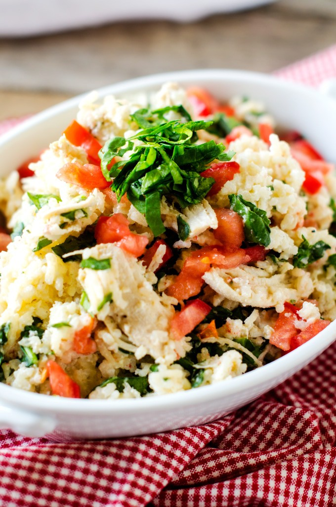 Slow Cooker Chicken and Rice with Feta and Spinach - This Slow Cooker Chicken and Rice is a fun twist on Chicken & Rice! I've added spinach, feta and tomato for a bit of a Mediterranean twist.