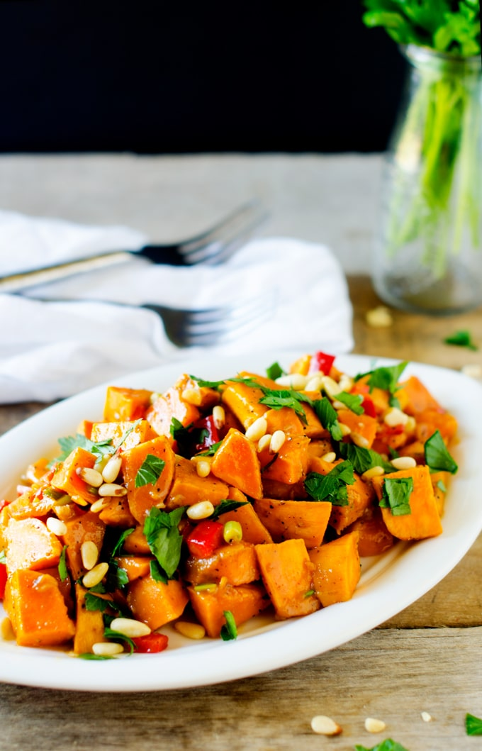 Roasted Sweet Potato Salad - This sweet potato salad is so easy to make and crazy delicious! The type of dish to keep in the fridge to help keep your clean eating on track! - WendyPolisi.com
