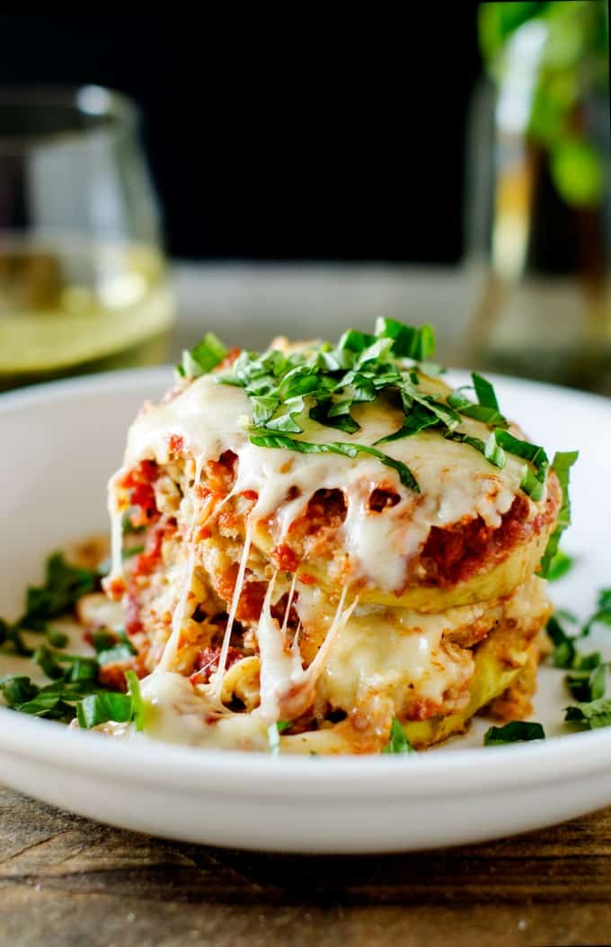 Close up photo of Slow Cooker Eggplant Parmesan with stringy cheese down the side.