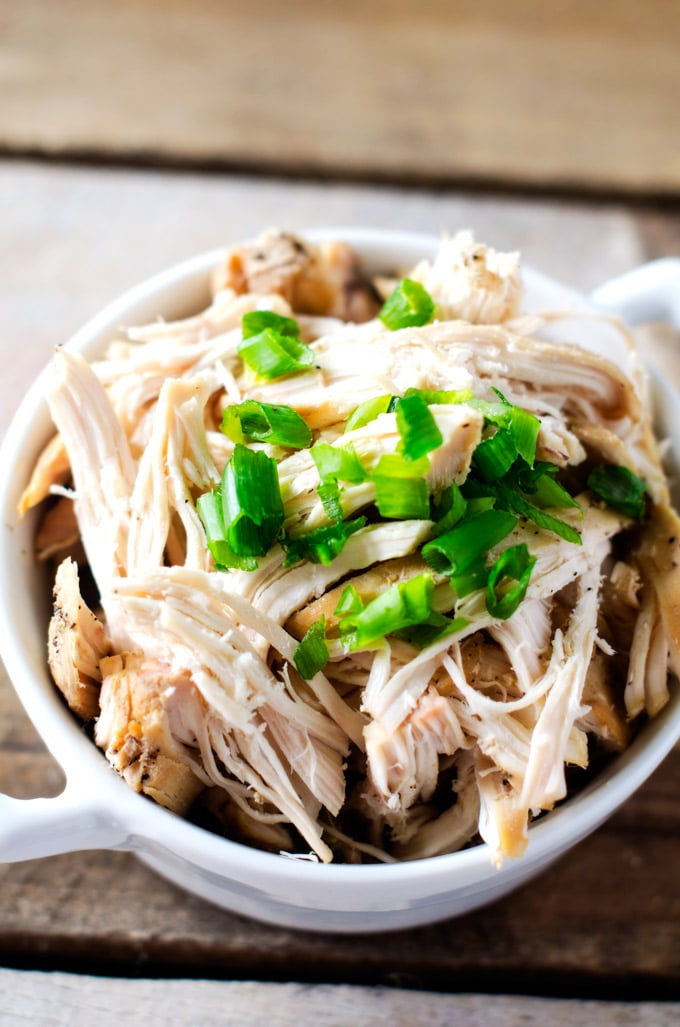 Easy Slow Cooker Shredded Chicken - This easy crockpot recipe helps you put healthy eating on auto-pilot. I love to make it on the weekends so that I have shredded chicken on hand to toss into salads, grain bowls, pasta dishes and burritos.