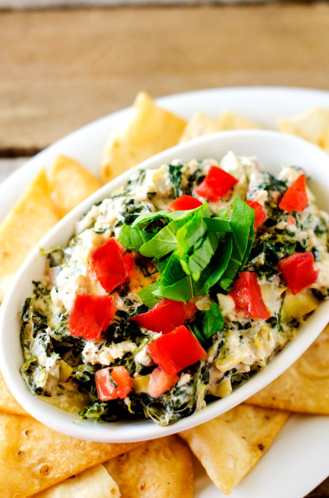 Slow Cooker Spinach Artichoke Dip - This easy to make Spinach Artichoke Dip is the best Spinach Artichoke Dip...EVER! It is packed with flavor with red onion, cream cheese, feta, parmesan, garlic and red pepper flakes. Perfect for effortless entertaining.- WendyPolisi.com