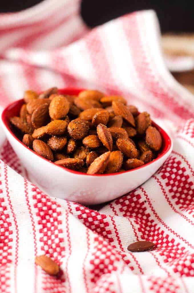 Spicy Slow Cooker Almonds in a small bowl on a red and white towel
