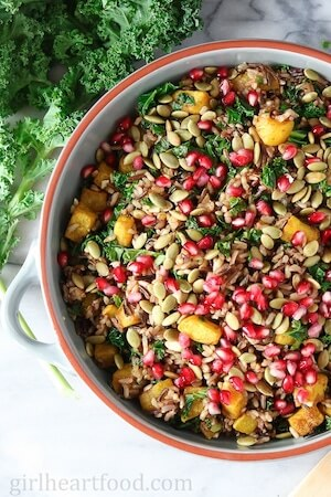 Photo of Harvest Wild Rice Salad in a red and white bowl.