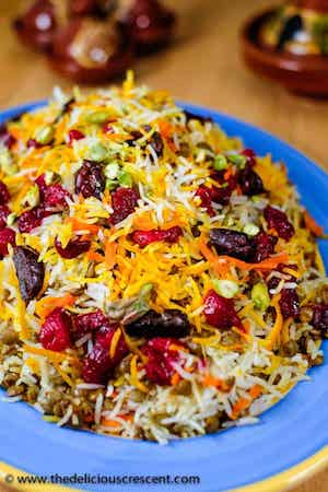 Close up photo of Lentil Cranberry Saffron Rice in a blue bowl.