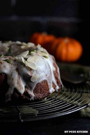 Photo of a pumpkin bundt cake against a dark background.