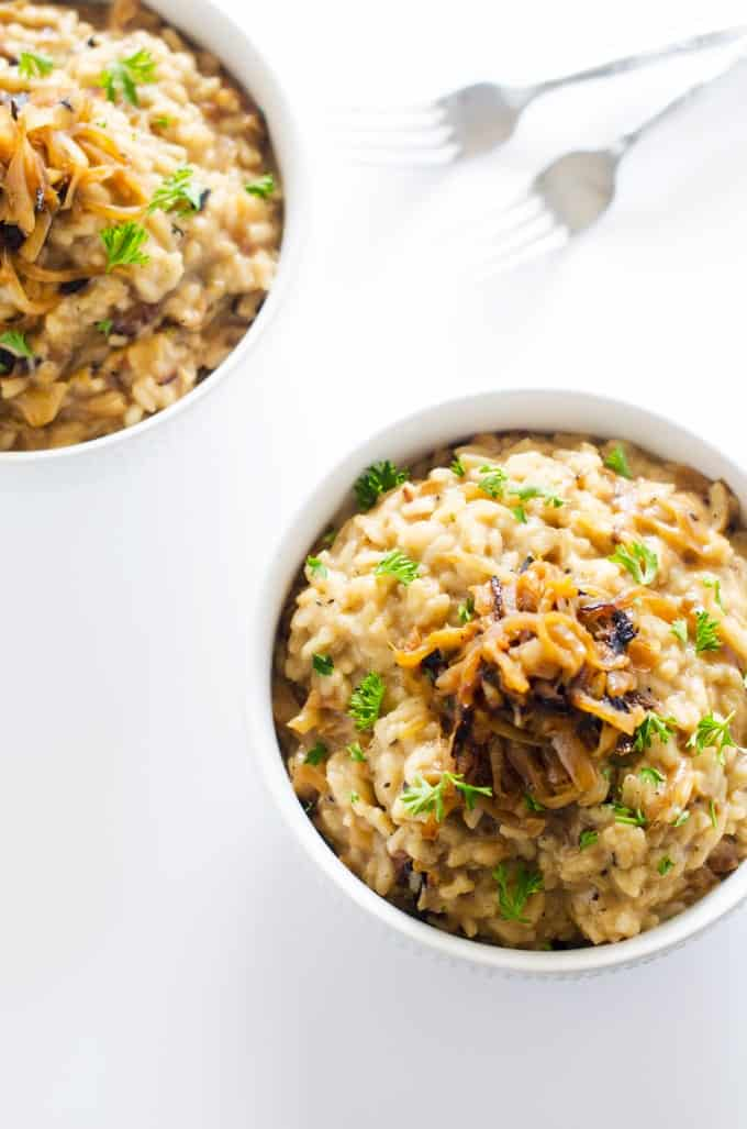 Overhead photo of a bowl of Caramelized Onion Risotto with part of another bowl in the corner.