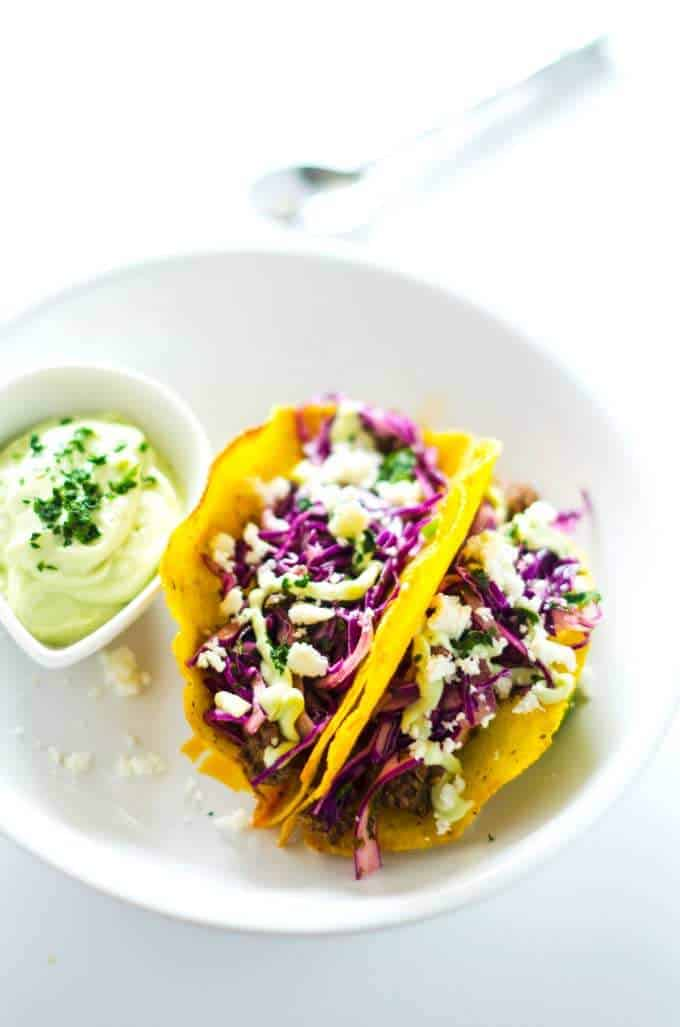 Photo of Beef Taco Recipe with Cilantro Slaw and Avocado Cream on a white background.