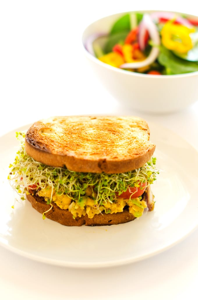 Avocado Chickpea Sandwiches with Smokey Almonds - This vegan and gluten free sandwich will have you not missing the meat! Keeps well in the fridge, making it the perfect weekday lunch! - WendyPolisi.com
