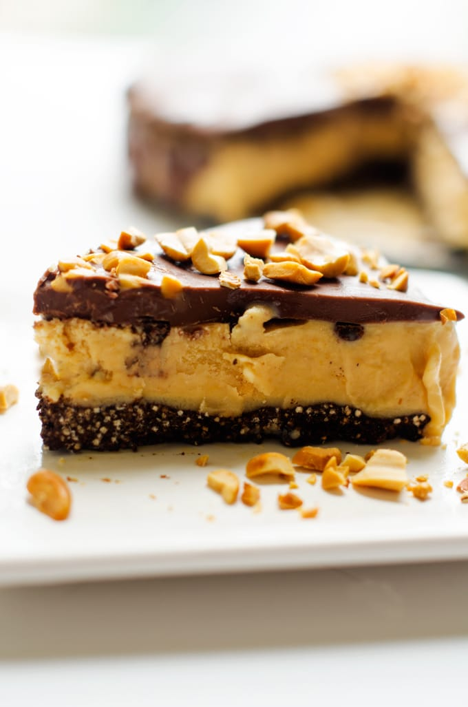 Frozen Chocolate Peanut Butter Cake with Chocolate Quinoa Crust - This gluten free frozen chocolate peanut butter cake is a dessert you can feel good about. With a quinoa crust, yogurt and peanut powder, this healthier dessert will please the whole family. - WendyPolisi.com