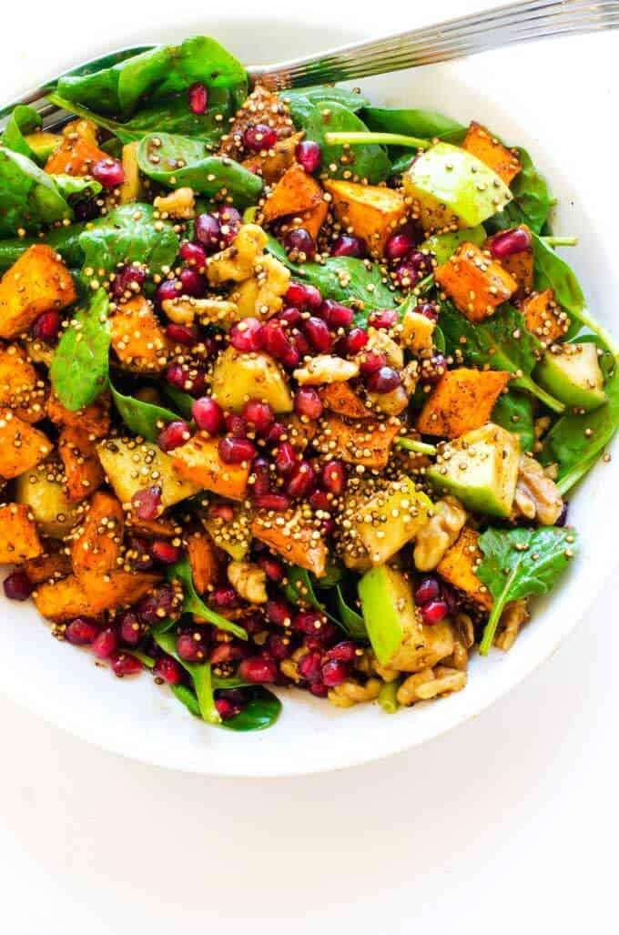 Close up ¾ overhead shot of Sweet Potato Quinoa Salad with Pomegranate