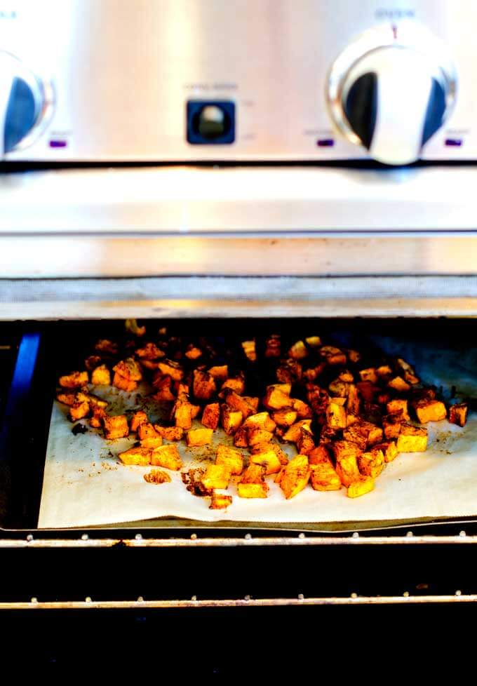 Photo of sweet potatoes roasting in preparation to make a Sweet Potato Quinoa Salad