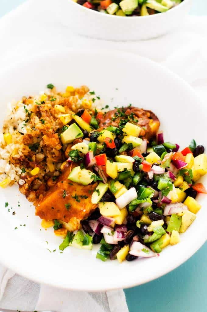 Photo of a Mango and Avocado Salsa Recipe over a tamale and rice.