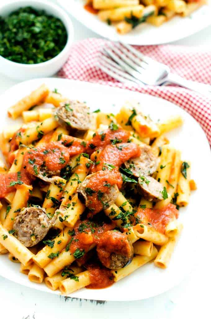 Up close photo of sausage spinach pasta.