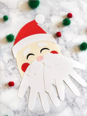 Photo of an easy Santa craft for kids . - DIY Handprint Santa.
