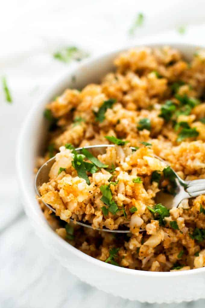 Cauliflower Spanish Rice in a white bowl.