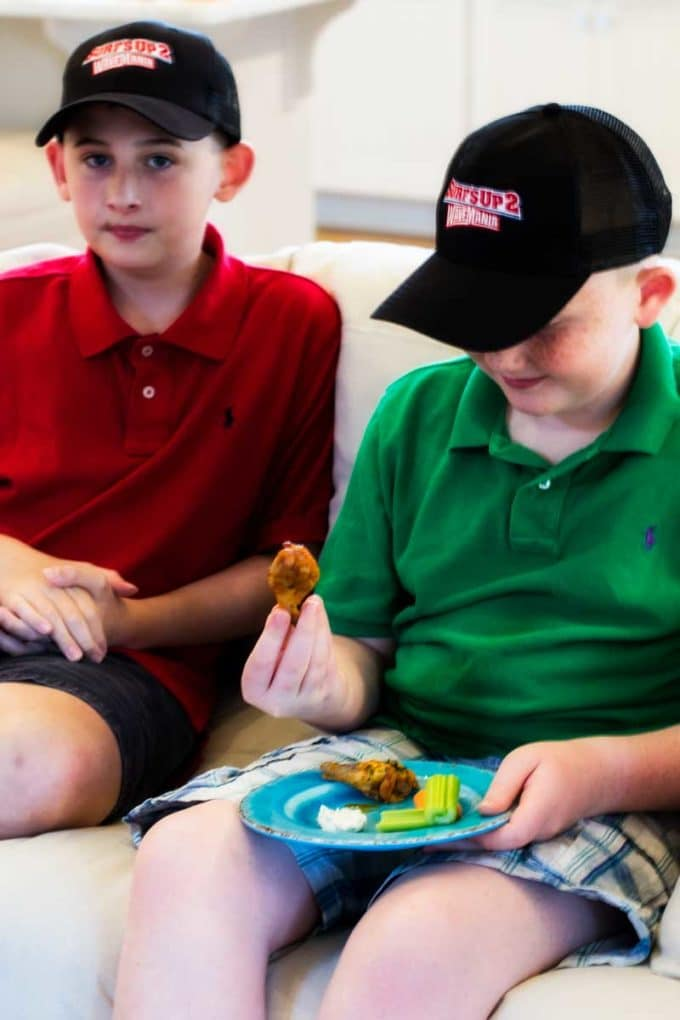 Photo of Boys eating Healthy Oven Baked Chicken Wings