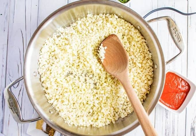 Cauliflower Spanish rice recipe cooking in a skillet