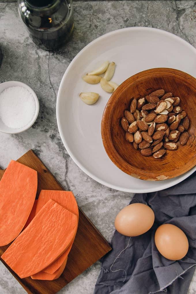 Sweet Potato Toasts with Egg, Parsley Almond Pesto, and Arugula
