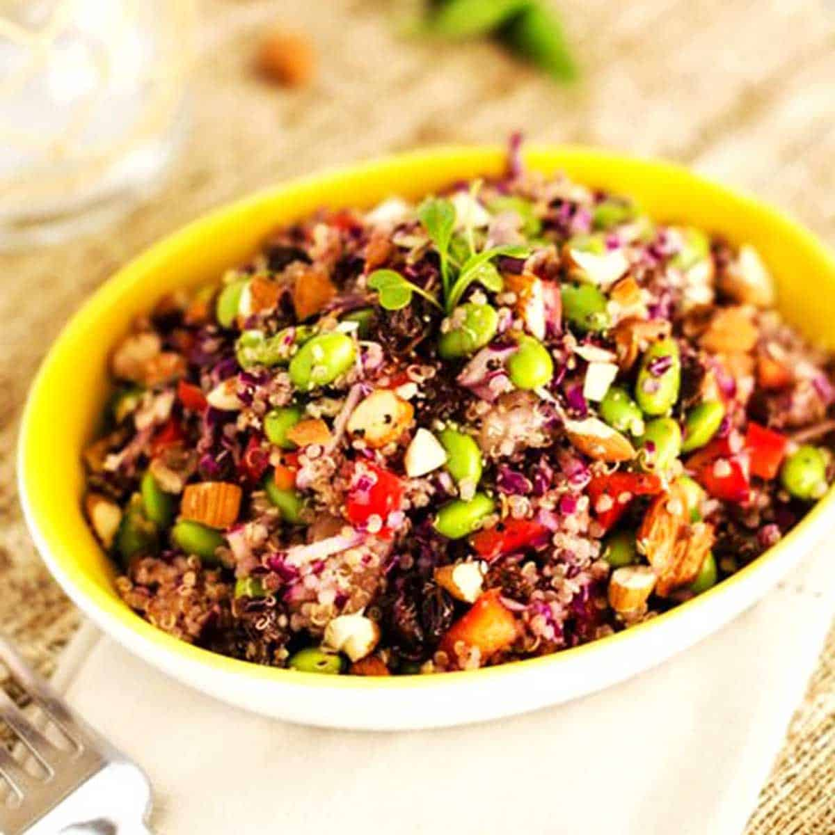 Photo of an Edamame Quinoa Salad in a yellow dish.