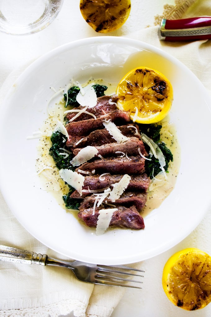 This Steak with Creamy Spinach & Parmesan is a simple but elegant meal that the whole family will enjoy. Perfect for your next grill out!
