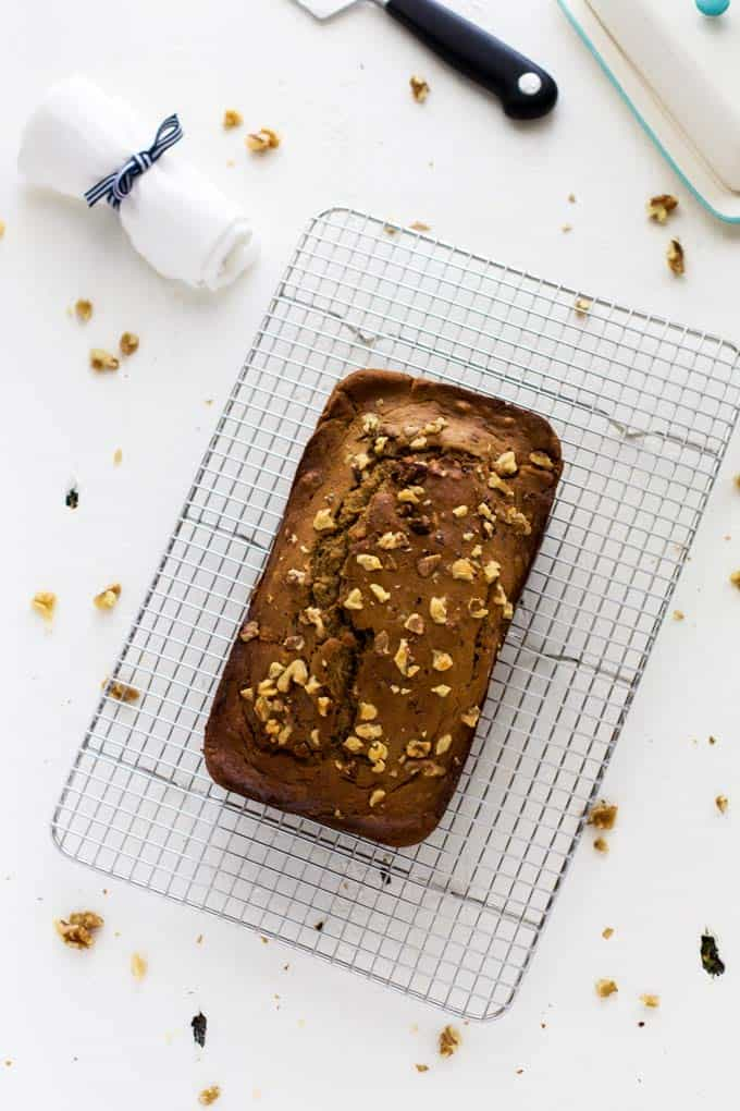Overhead photo of Quinoa Banana Bread on a wire cooling rack.