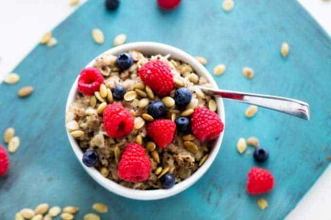 Horizontal Shot of Quinoa & Oats Breakfast Bowl with berries on top.