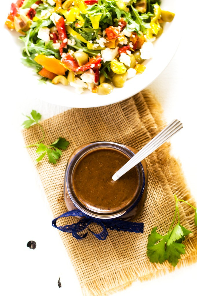 Shot of a Balsamic Vinaigrette Dressing Recipe and colorful salad