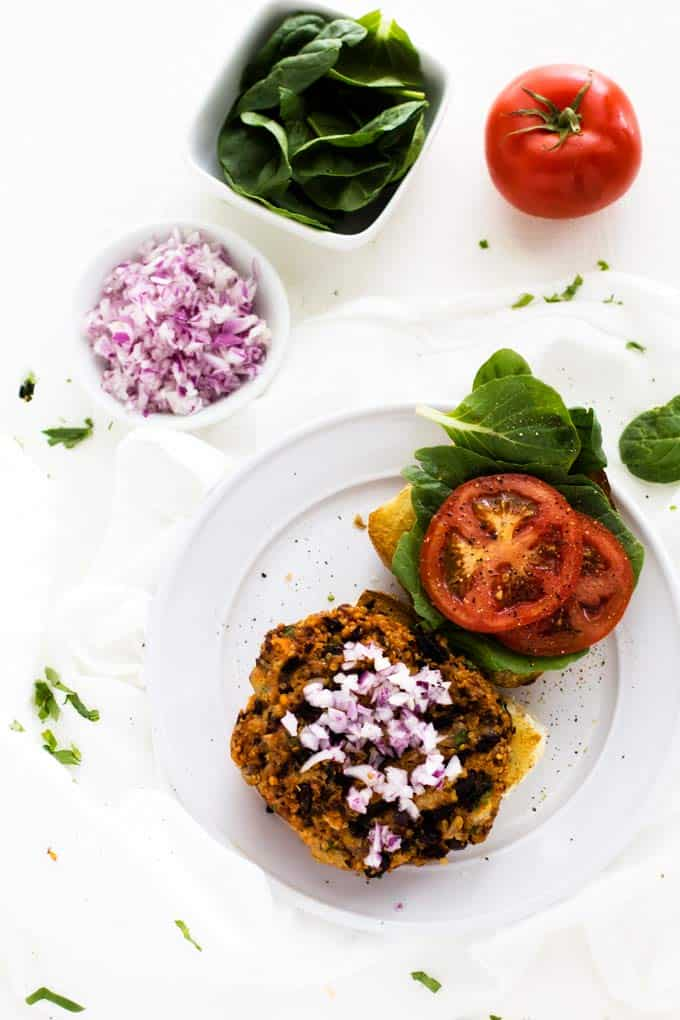 Overhead image of prepared Black Bean and Quinoa Burger Recipe on a white background.