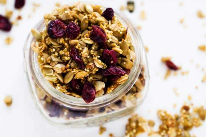 Horizontal shot of Gluten Free Quinoa Granola in a glass jar.