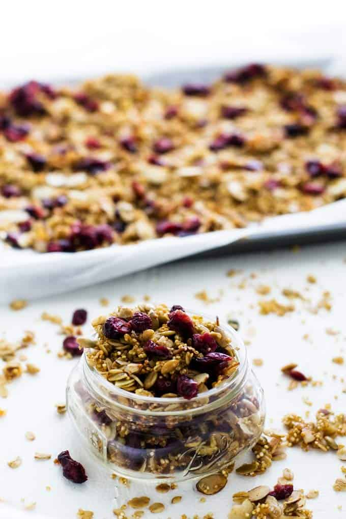 Gluten Free Quinoa Granola on a sheet plan and in a jar.